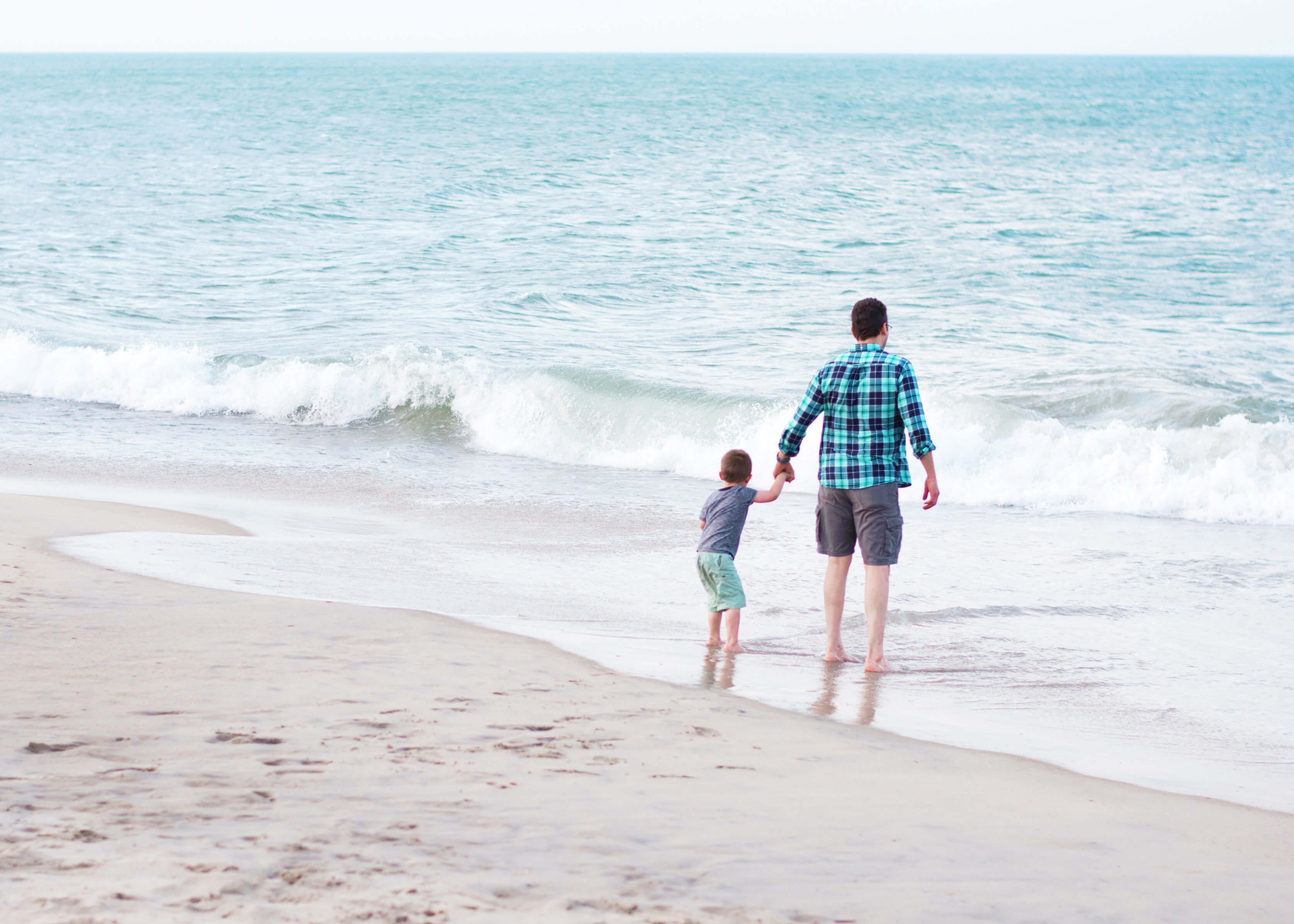 Man and son on the beach